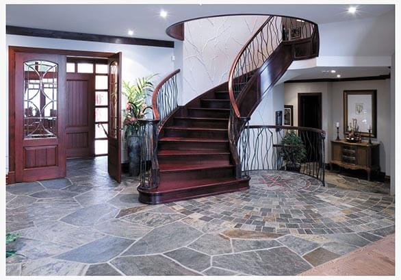 stairway with three door barrier one piece of furniture two plant floor with slate and frame