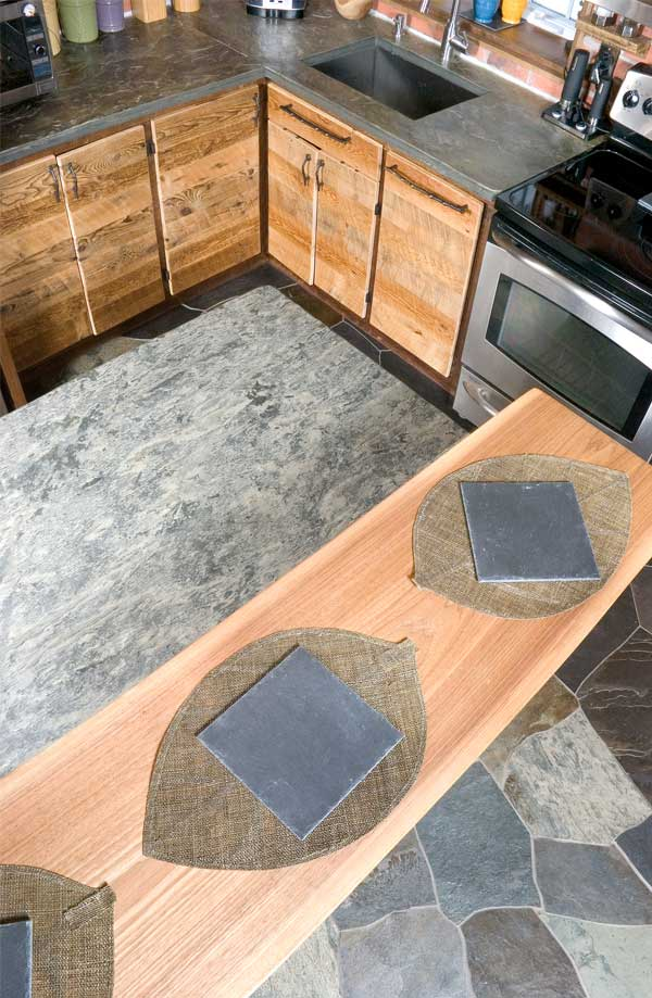 Slate countertops, kitchen island, floor boards and serving trays