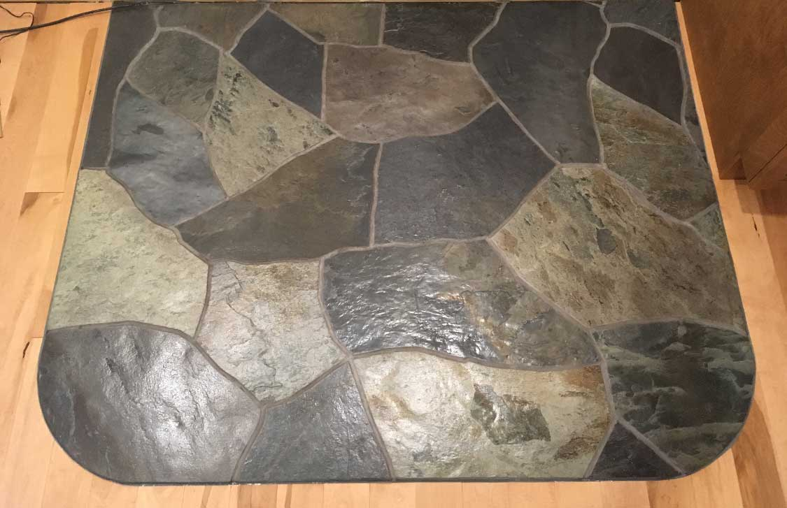 Terra-Nova tiles inserted in wooden floor